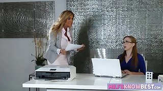 Busty MILF and nerdy teen scissoring on the office desk