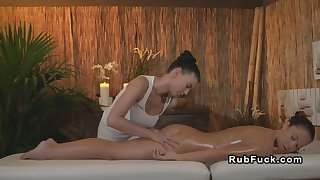 Huge tits oiled masseuse fingers her lesbian customer