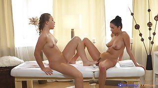 Two busty lesbians are deliberate each other during massage session