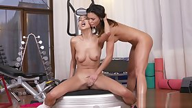 Redhead Asian and brunette lesbians at gym