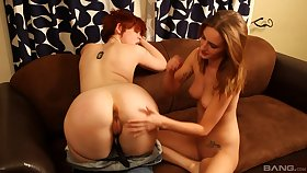 Smooth lesbian lovemaking on the sofa between Lily Cade and Maci Winslett